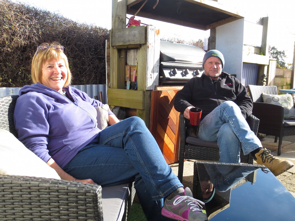 Marion Whyte & Paul Dayman in their courtyard at Tahuna Beach Holiday Park