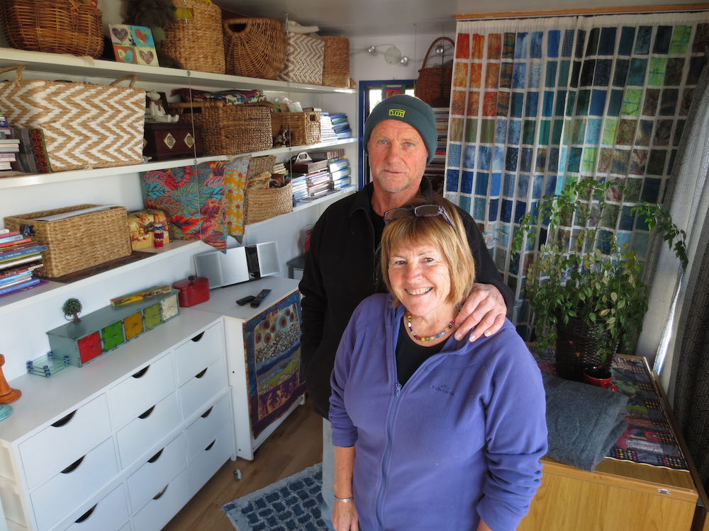 Paul Dayman & Marion Whyte in the annexe with Marion's quilting materials