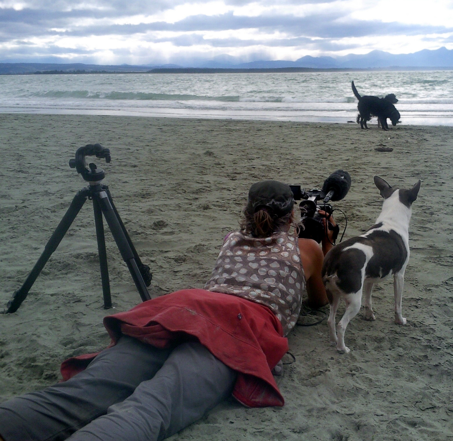 Ro Cambridge filming on the back beach at Tahuna